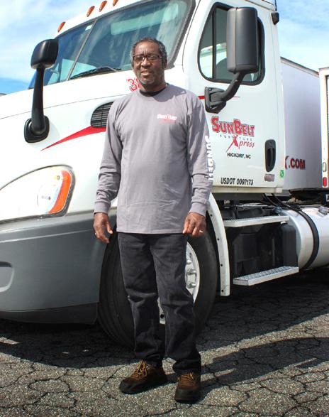 SunBelt employee standing in front of a truck